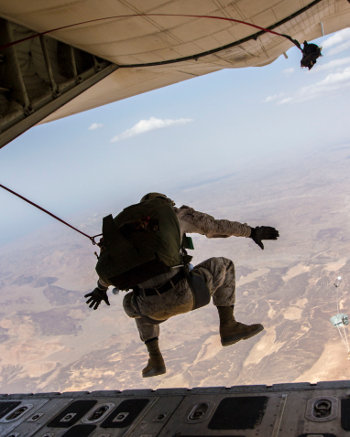 A U.S. Marine with the 26th Marine Expeditionary Unit's Maritime Raid Force conducts double bag static line parachute operations from a KC-130J Super Hercules aircraft assigned to Marine Aerial Refueler Transport Squadron (VMGR) 352 over Djibouti Aug. 10, 2013. Marines with the 26th Marine Expeditionary Unit deployed with the Kearsarge Amphibious Ready Group in the U.S. 5th Fleet area of responsibility. (DoD photo by Sgt. Christopher Q. Stone, U.S. Marine Corps/Released)